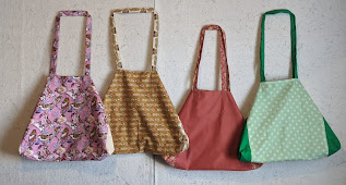Four tote bags in a variety of colors make overnight bags for foster children