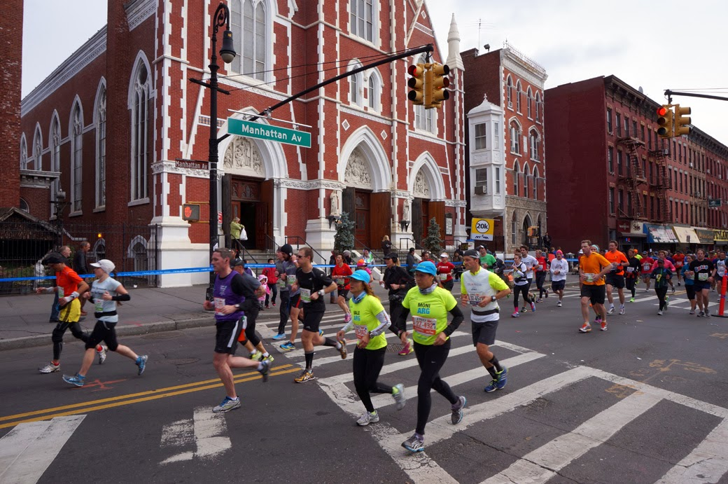 New York City Marathon runners with church in background
