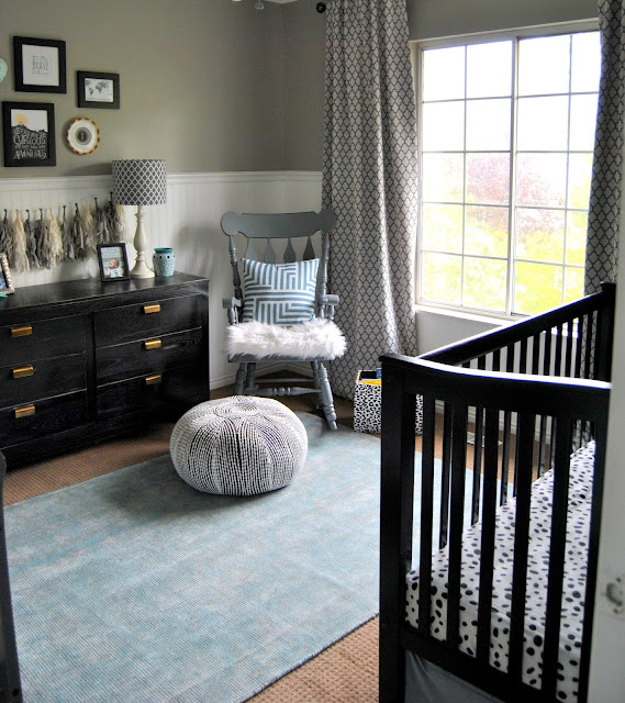Nursery, Boy Nursery, Black Crib, Gallery Wall, Faux Taxidermy, Faux Elephant Head, Adventure Themed Nursery, Safari Theme, Neutral Nursery, Black and White, Zebra Head, Black Crib, Board and Batten, Curtains, Trellis, Bead Board, Arrows, Pouf, Rocking Chair, Vintage, Black Dresser, Brass Hardware, Vintage Dresser, Rug, Rugsusa, Rugs Direct, Blue Rug, Mint, Mint Nursery, Turquoise, Blue Nursery, Boy Nursery, Gender Neutral Nursery, Gray Nursery