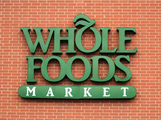 A picture of a Whole Foods Market sign.
