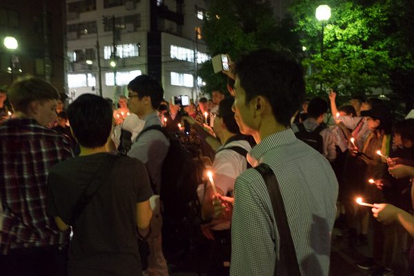 Candlelight vigil for Orlando victims, listening to speakers, Shinjuku, Tokyo, Japan.