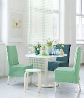 Pop color dining chairs in white dining room