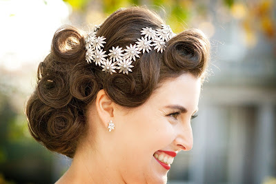 Vintage pin curls on smiling bride in profile with flower detailed tiara