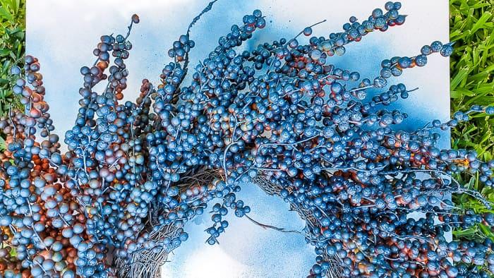 spray painting berry wreath blue