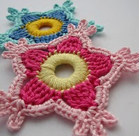 http://www.mycrochetprojects.com/blog-content/uploads/2012/07/The-first-paradise-flower.pdf
