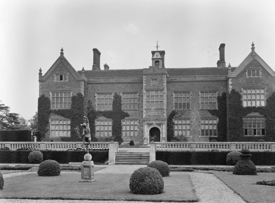 Photograph of North Mymms House as seen from the north, 1902. Note the Coningsby crest of three cronies above the front door.