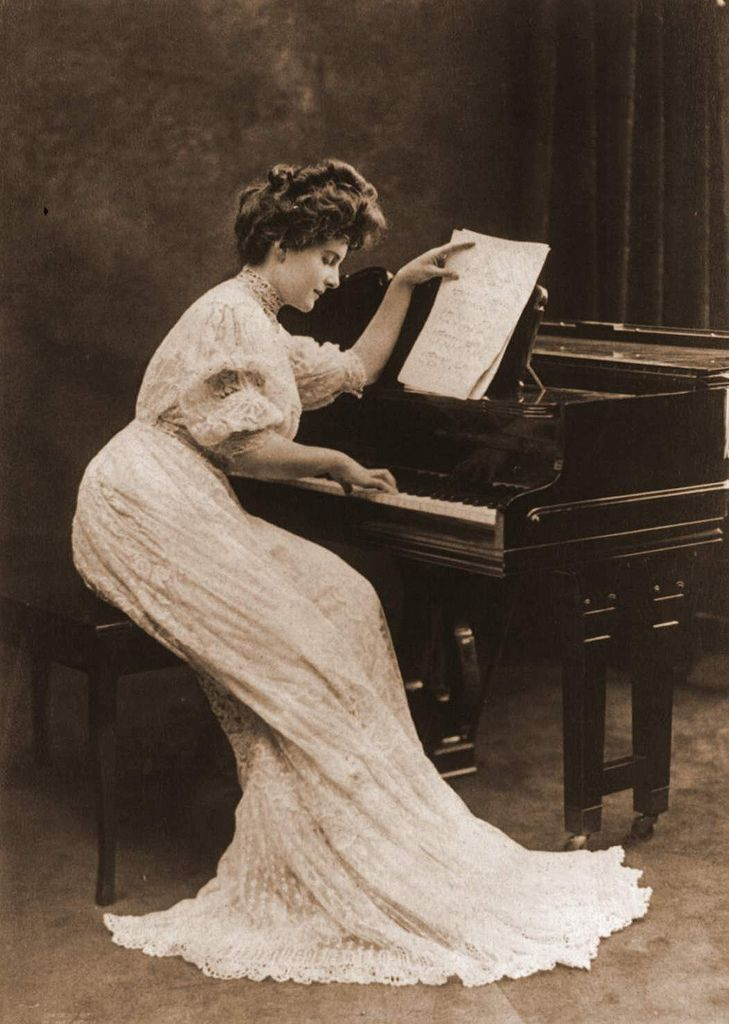 Vintage photo. Beautiful Edwardian era woman plays the piano.  Jingles and other stories of The American Dream. marchmaton.com