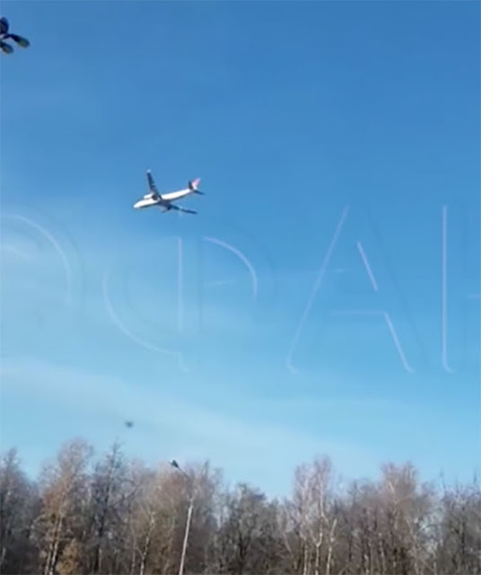 Plane in mid air just suspended in a motionless position.