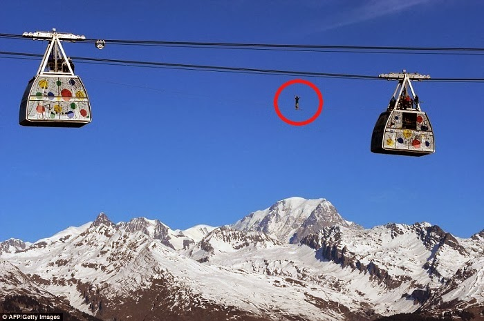 French Highliner Performs Death-Defying Walk On Cable Car Wire 1,200ft Above Mont Blanc In The...