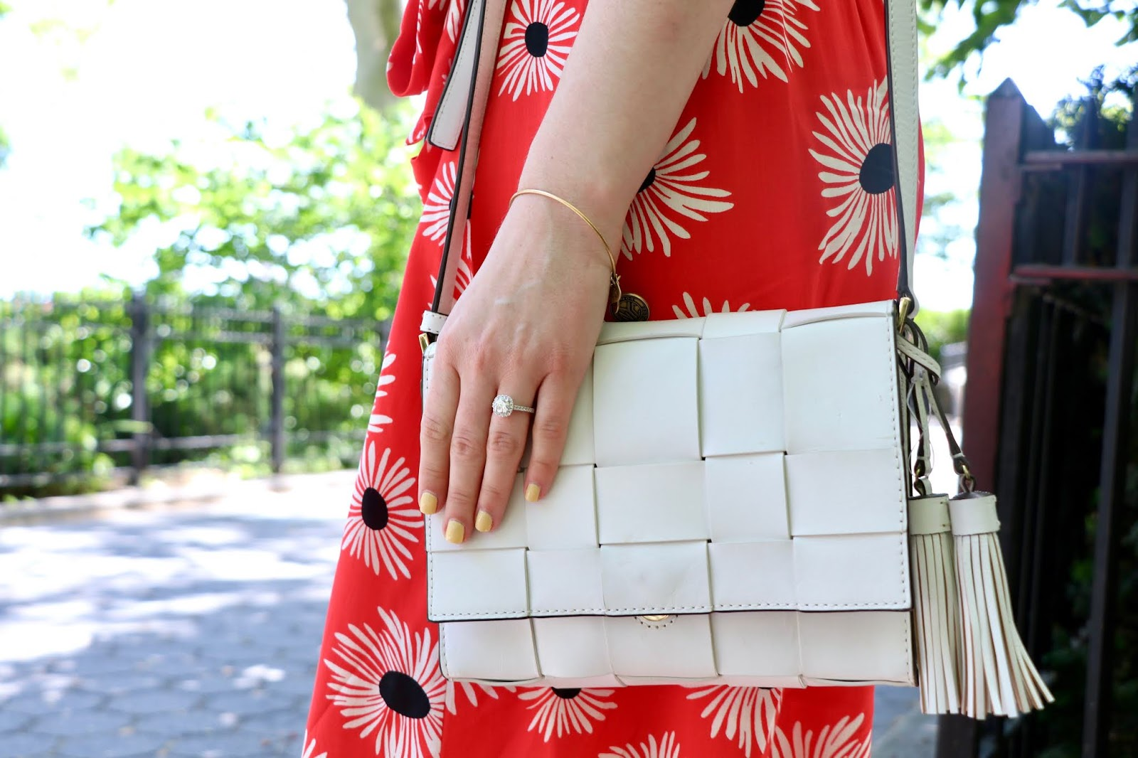 Nyc fashion blogger Kathleen Harper wearing a white Michael Kors purse.