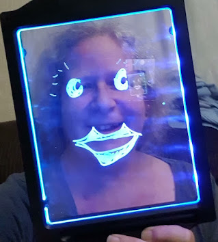 Light Up Drawing Board drawing of face superimposed over real person standing behind