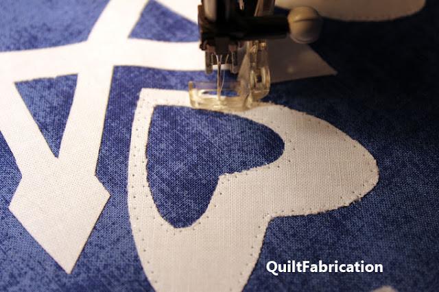 stitching down snowflake appliques