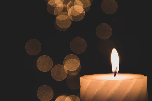 Photo by Mercedes Bosquet on Unsplash candle