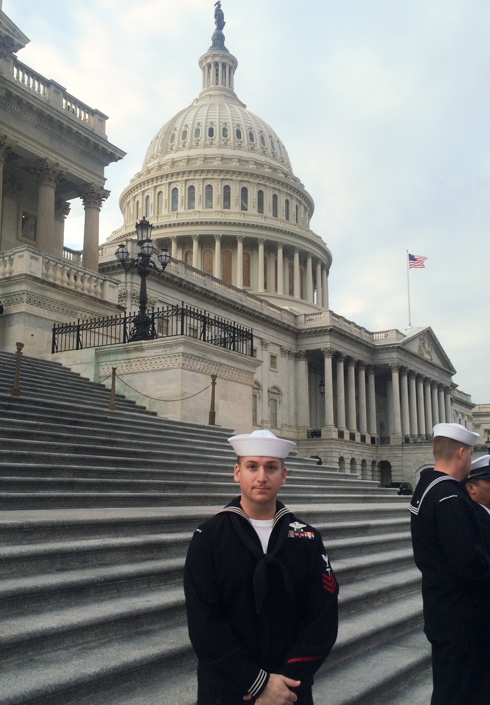 Navy sailor standing in front of the Capitol Building