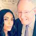 Kim Kardashian poses with Forbes Media CEO, Steve Forbes