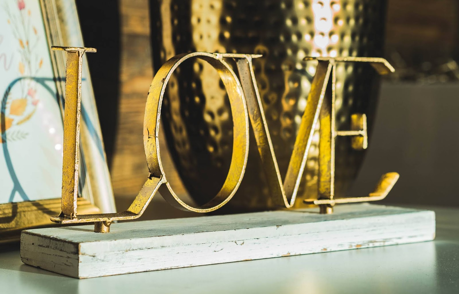 gold love freestanding letters table decor on top of white surface, love images