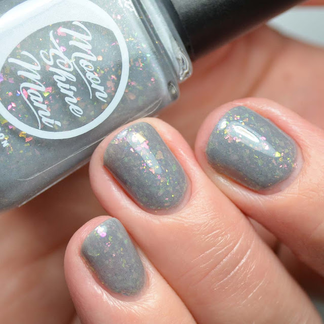 grey nail polish with flakies swatch