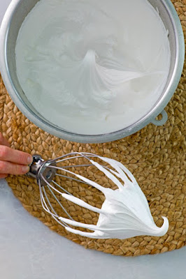 mixer bowl of egg whites whipped to stiff peak