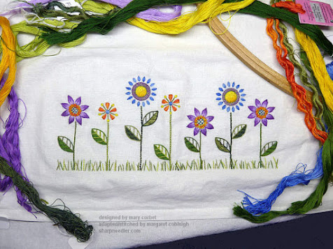 Embroidery complete on flour sack towel with flowers
