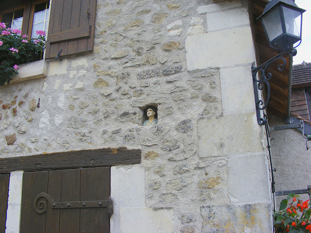 Ceramic bust in a niche on the exterior of a house. Indre et Loire. France. Photo by Loire Valley Time Travel.