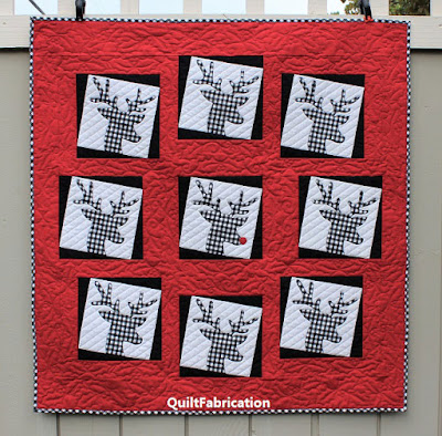red, black, and grey reindeer wreath wall hanging by QuiltFabrication