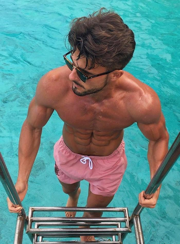shirtless-ripped-male-sixpack-abdominal-muscles-shredded-tanned-body-beard-luxurious-sunglasses-pool