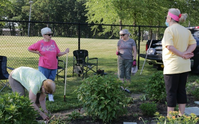 Crown Point Garden Club maintenance and mulch day at the Lake County Fairgrounds Pollinator Garden