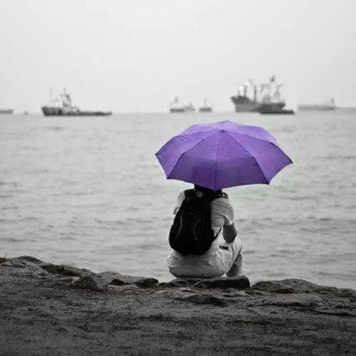 Sad girl with purple umbrella
