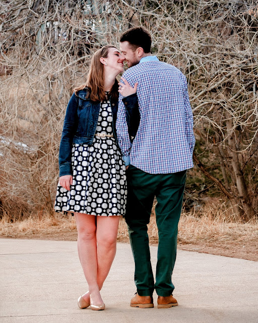 a couple goes in for a kiss during an engagement session in Boulder Colorado