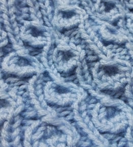 http://translate.google.es/translate?hl=es&sl=en&tl=es&u=http%3A%2F%2Fwww.knitaholics.com%2F2013%2F11%2F04%2Fhow-to-knit-knitting-stitch-dandelion%2F