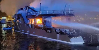 Out-News = Super Yacht Burns then Sinks in Olbia Yacht Marina