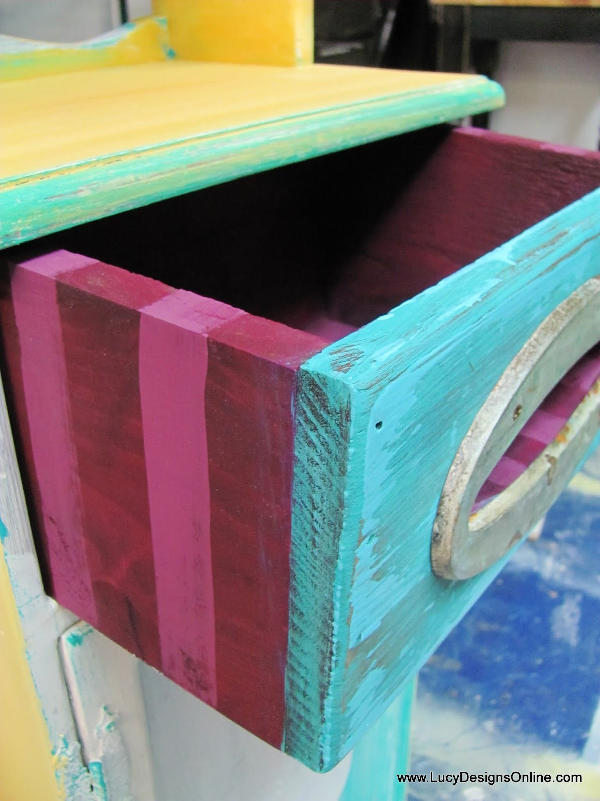 funky painted striped wooden cabinet
