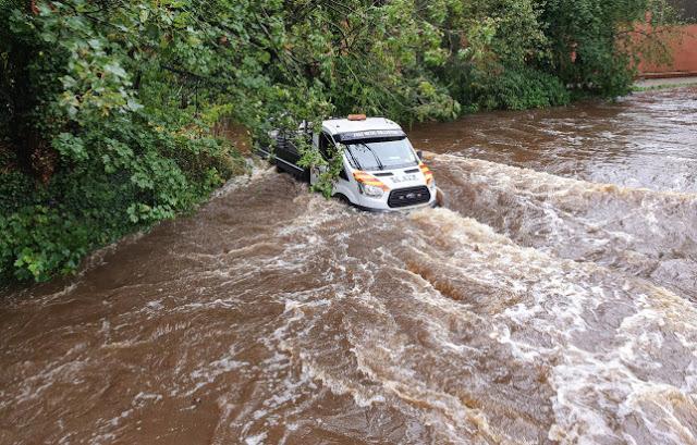 vans flowing in flood