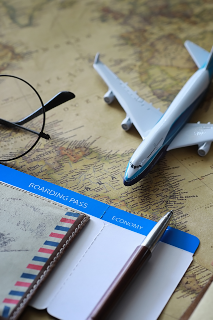 Planning a trip requires a map, a pair of glasses and a model airplane