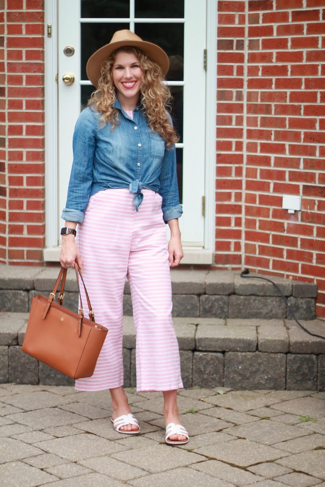 6 Ways to Wear a Striped Jumpsuit, pink striped jumpsuit, chambray top, wide brim straw hat, blue floral tie neck blouse, chambray heels