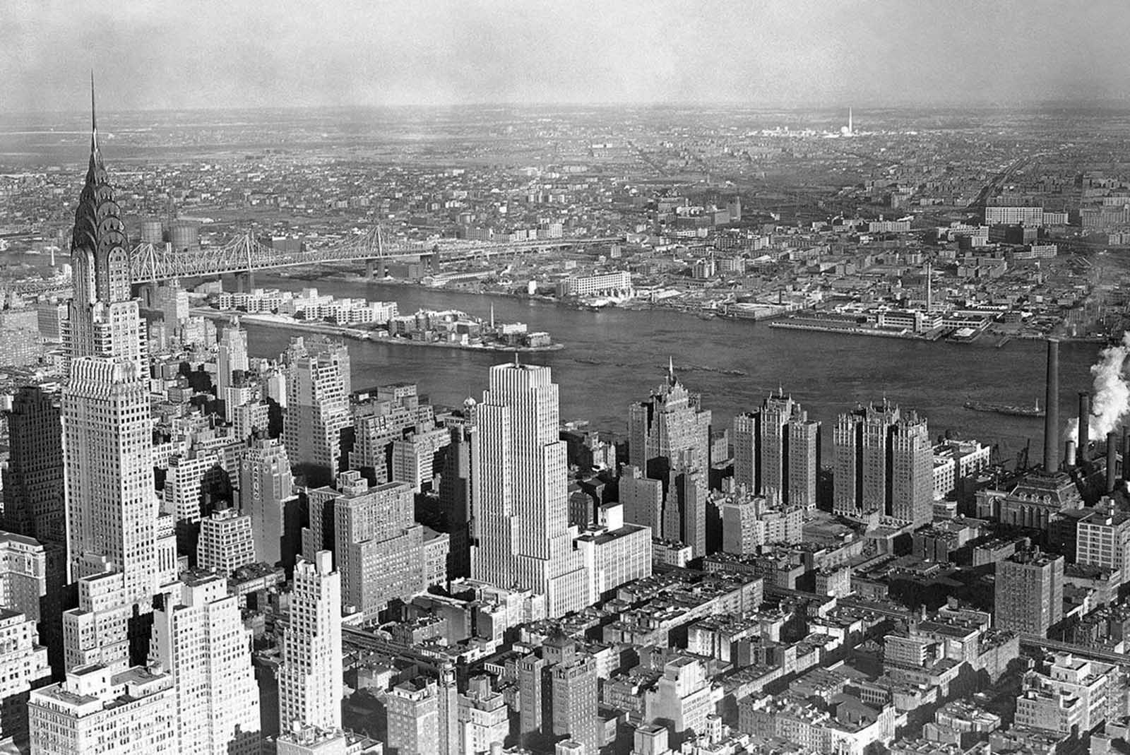 The World's Fair buildings now nearing completion over seven miles away (upper right) can be seen in the distance from the top of the Empire State Building in New York, on February 27, 1939.