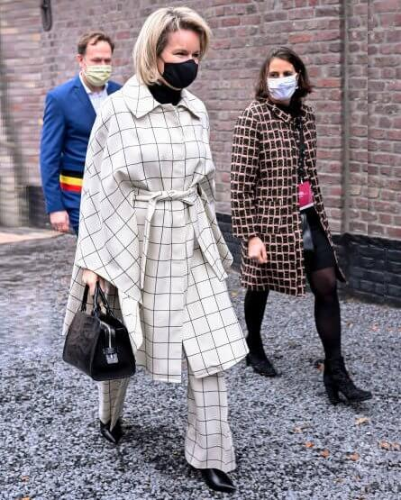 Queen Mathilde wore a new nevil check wool canvas cape and trousers from Natan. The Queen's new outfit is from the fashion house Natan