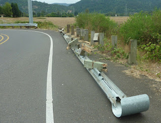 Highway guard rail broken from car crash