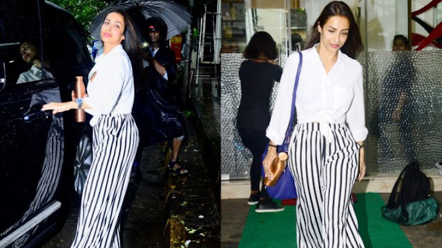 Malaika Arora's fashion game seems on point as she was spotted in white shirt and striped pants