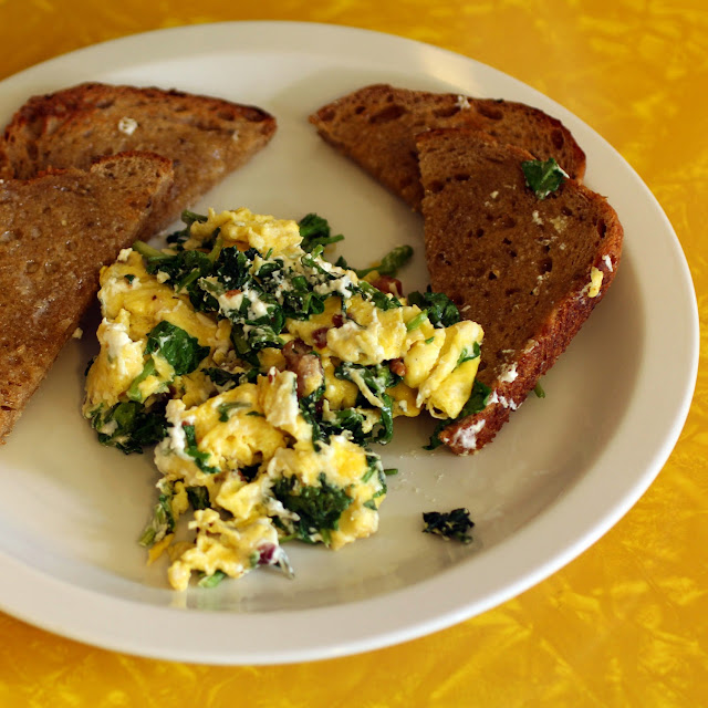 watercress goat cheese scrambled eggs w/bacon served with sourdough toast