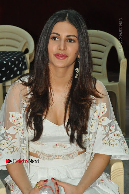 Telugu Actress Amyra Dastur Stills in White Skirt and Blouse at Anandi Indira Production LLP Production no 1 Opening  0003