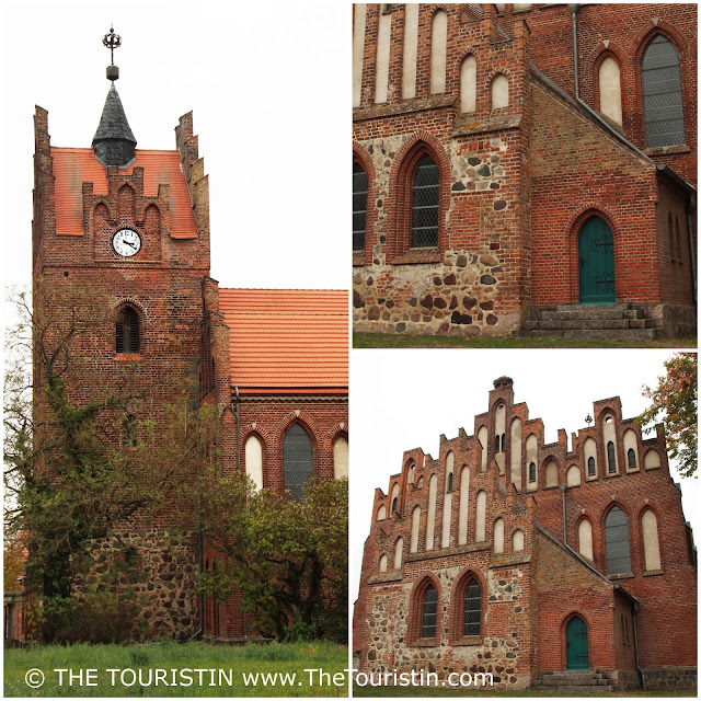 The clocktower, a green door and the main facade of a red brick gothic church.