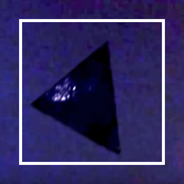 Black triangle UFO caught on camera over Chicago.