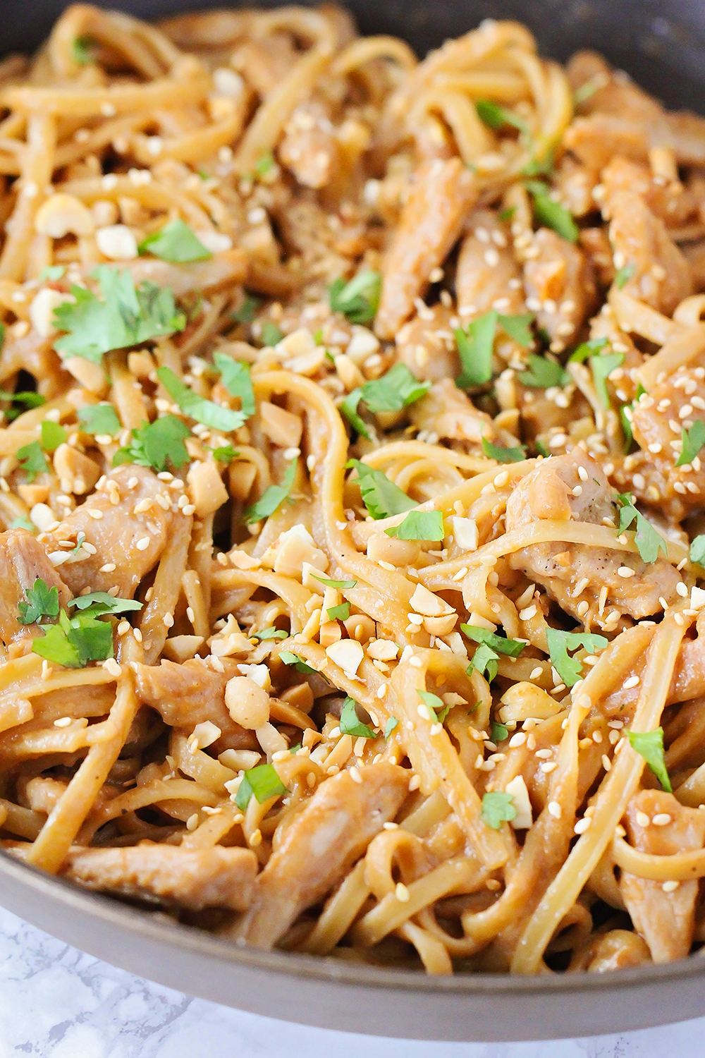 These flavorful and savory sesame peanut noodles are a simple and delicious dinner that's ready in about thirty minutes!