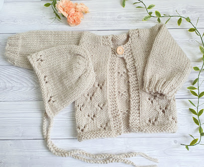 beige lacy baby cardigan handknit outfit