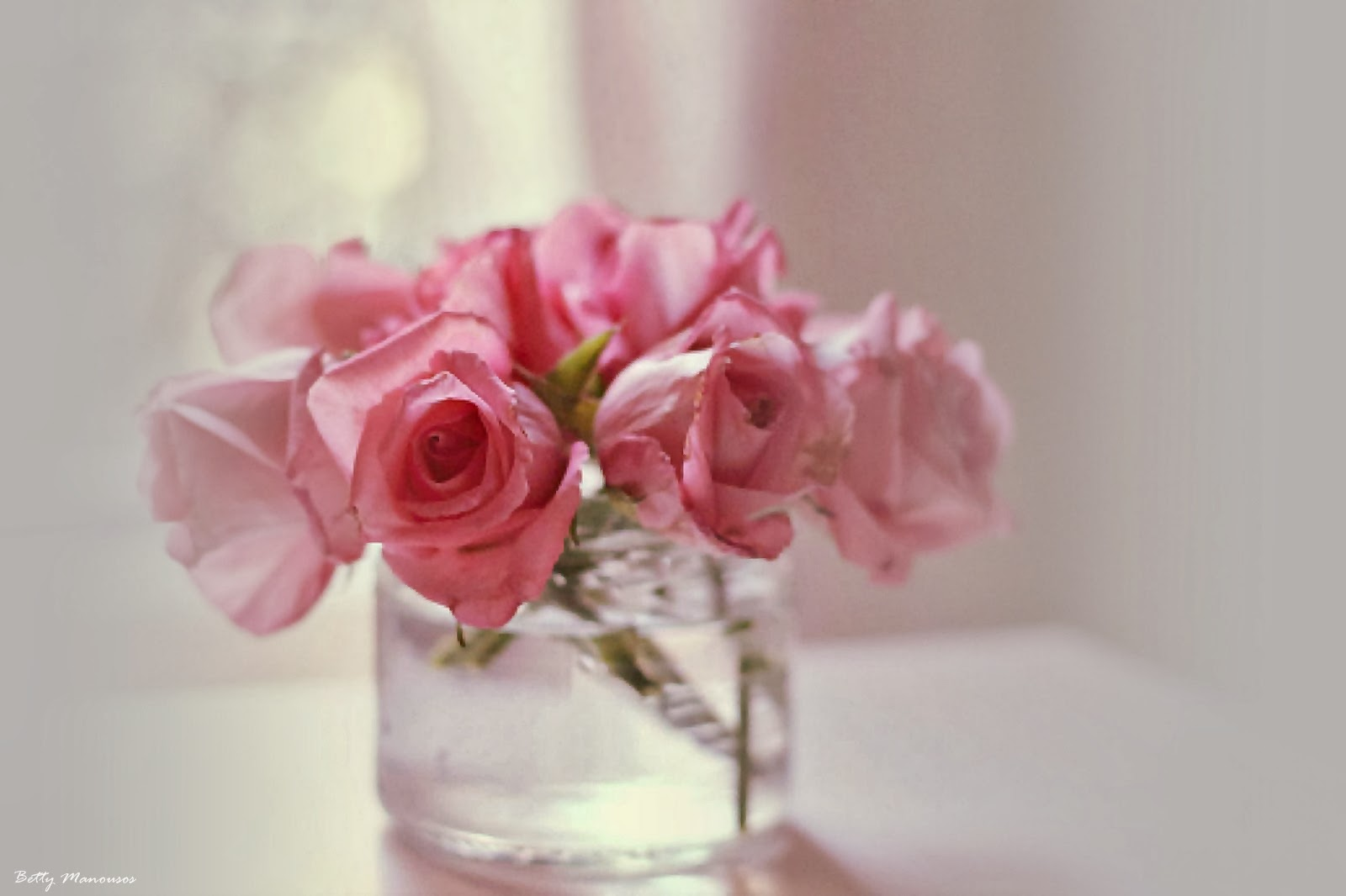 pink roses in a crystal vase