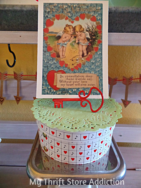 How to Create Seasonal Vignettes with Vintage Collections mythriftstoreaddiction.blogspot.com Vintage scale and valentine vignette