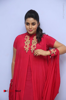 Actress Poorna Latest Stills in Red Dress at Rakshasi First Look Launch  0032.JPG