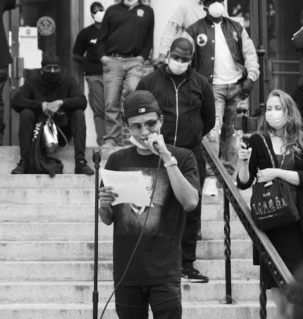 """Recording artist Niko Brim speaks at Mount Vernon City Hall in New York during """"We Can't Breathe"""" rally on Tuesday, June 2, 2020."""