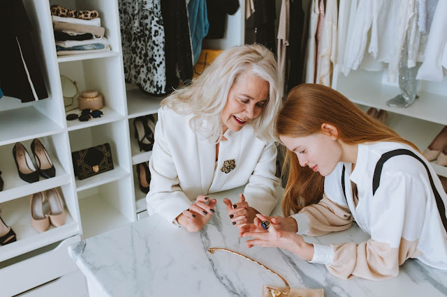 Two women looking at accessories at a jewelry store.